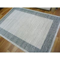 Trendy Contemporary Floor Rugs Emphasis Plain Frame Grey Cream InStore